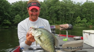 Kyle with hybrid crappie weighing 2 plus pounds.