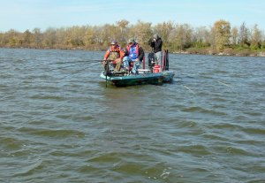 Russ Bailey and camera crew record the crappie action on Rend Lake for upcoming TV program.
